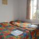 Twin bedroom, Villa Shiraz Cala en Porter
